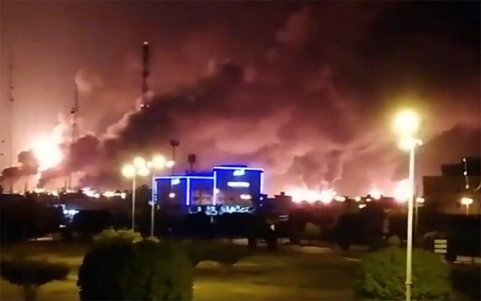 Smoke is seen following a fire at an Aramco factory in Abqaiq, Saudi Arabia, September 14, 2019 in this picture obtained from social media (video obtained by Reuters)