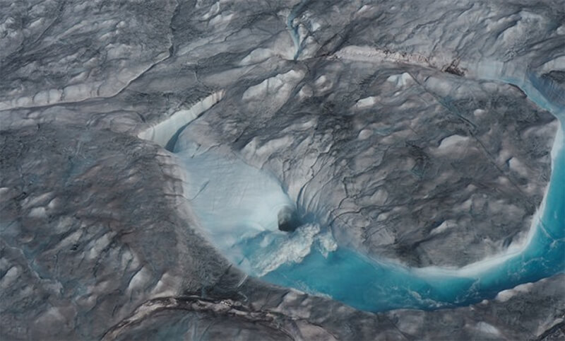 A view of ice melting during a heatwave in Kangerlussuaq, Greenland is seen in this August 1, 2019 (image obtained via social media- Reuters)