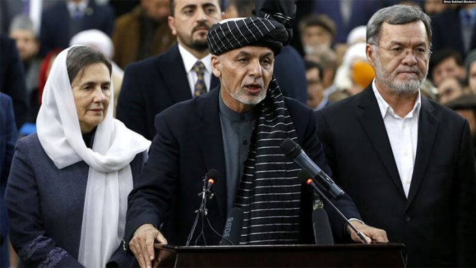 Afghan President Ashraf Ghani (center) is up against warlords, former communists, and mujahedin. (photo Omar Sobhani, Reuters)