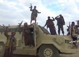 Houthi fighters with captured SA vehicle (photo Al Masirah/Houthi Military Media Center/Reuters TV)